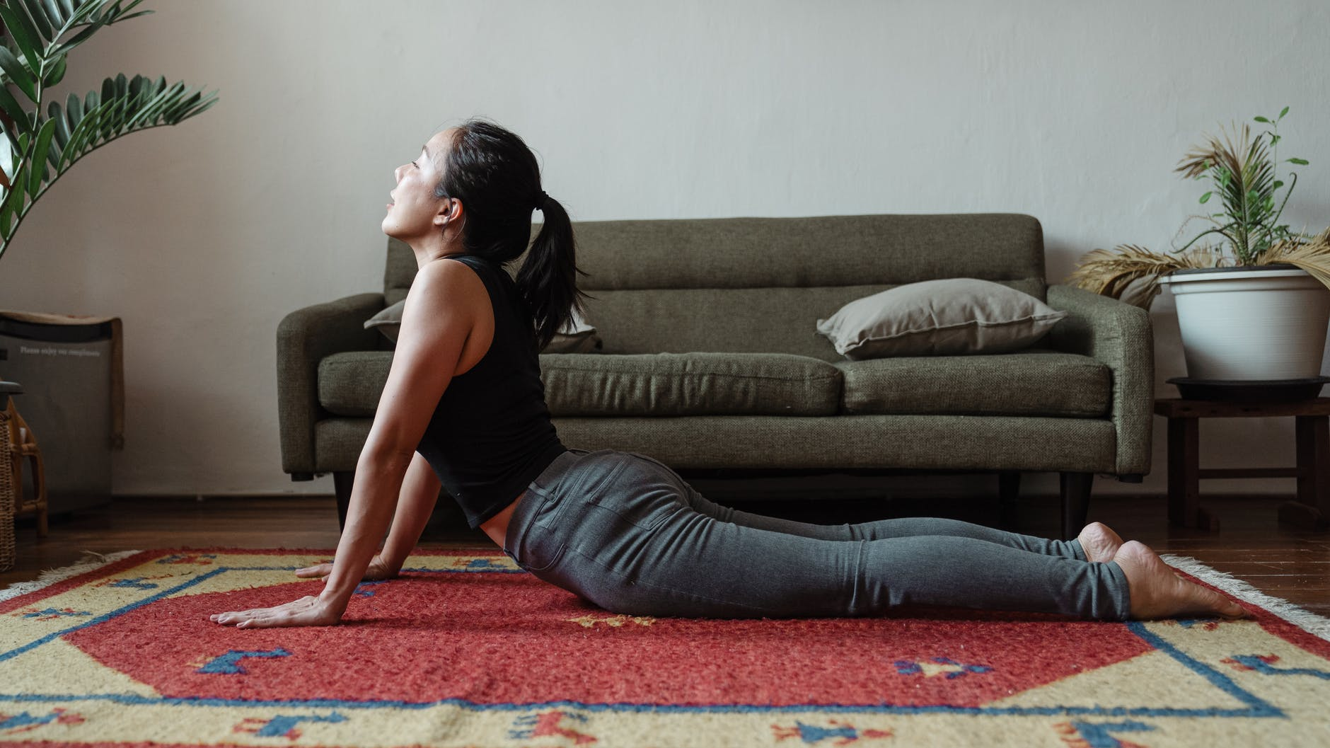 young asian woman doing yoga pose